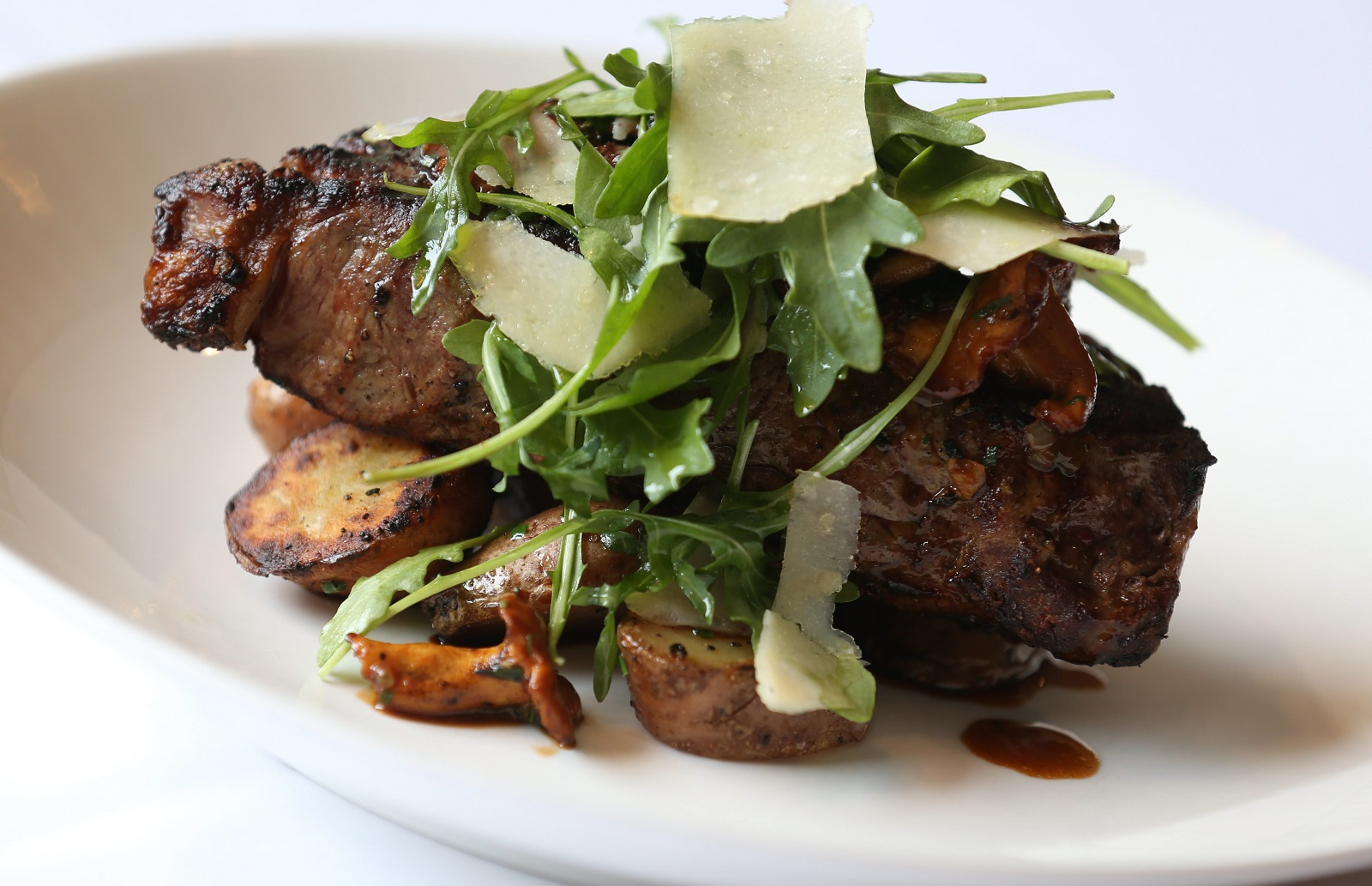 Tempo Restaurant is located at 581 Delaware Ave. in Buffalo.  This is the 28-day dry aged NY strip with fingerling potatoes, wild hedgehog mushrooms, arugula and parmesan.  Photo taken, Wednesday, March 11, 2015.  (Sharon Cantillon/Buffalo News)